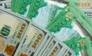 Тенге слабеет к доллару
